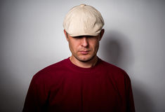 Portrait of a man wearing a cap pulled down Royalty Free Stock Photos