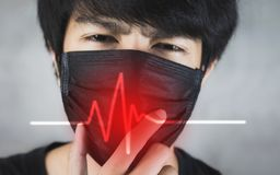 Portrait of man wearing pollution prevention or flu mask with danger. stock photography