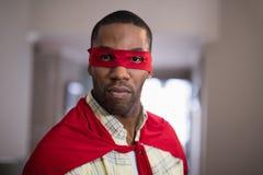 Portrait of man wearing superman costume Stock Photos