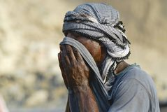 Portrait of a man wearing traditional head scarf in Aden, Yemen. Stock Photos
