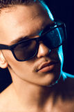 Portrait of man in wet sunglasses Royalty Free Stock Images