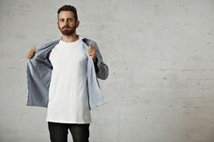 Portrait of a man in white t-shirt and denim Royalty Free Stock Photo