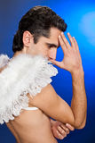 Portrait of man with white wings. Stock Photos
