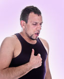 Portrait of man who has chest pain royalty free stock photo