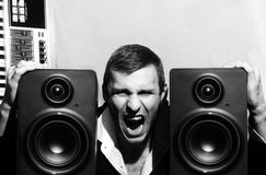 Portrait of a man who shouts with music speakers Royalty Free Stock Image