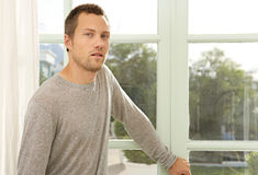 Portrait of man by window. Royalty Free Stock Photos