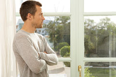 Portrait of man by window. Stock Image