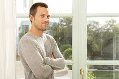 Portrait of man by window. Royalty Free Stock Photography