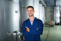 Portrait of man winery worker on wine factory in secondary fermentation section Royalty Free Stock Photo