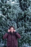 Portrait of a man in a winter forest near a spruce royalty free stock photos
