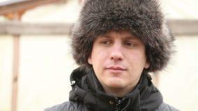 Portrait of a man in winter fur hat stock video
