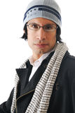 Portrait of a man in a winter jacket. Close up shot of a man in a winter jacket and hat Royalty Free Stock Photography