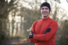 Portrait Of Man On Winter Run Through Woodland Royalty Free Stock Image