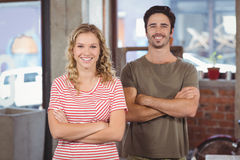 Portrait of man and woman with arms crossed in office Stock Image