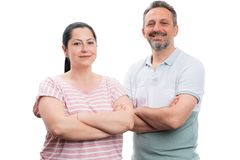 Portrait of man and woman with arms crossed. Portrait of cheerful men and women couple standing with arms crossed isolated on white background royalty free stock image