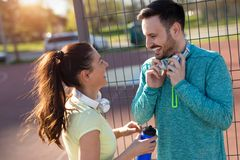 Portrait of man and woman during break of jogging stock image