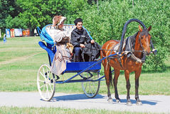 Portrait of man and woman in a carriage. Royalty Free Stock Images
