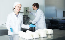 Portrait of man and woman dressed in lab coats are looking happy Stock Image