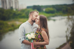 Portrait of a man and woman with flowers in nature on the background of the river Stock Photos