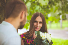 Portrait of a man and woman with flowers in nature Royalty Free Stock Images