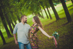 Portrait of a man and woman with flowers in nature Royalty Free Stock Photography