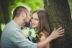 Portrait of a man and woman with flowers in nature Stock Photos