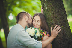 Portrait of a man and woman with flowers in nature Stock Image