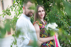 Portrait of a man and woman with flowers in nature Royalty Free Stock Image