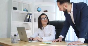 Portrait of a man and a woman in front of a laptop computer Stock Images