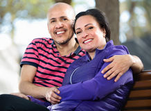 Portrait of a man and a woman happily embracing each other Stock Images
