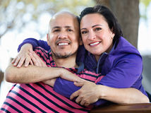 Portrait of a man and a woman happily embracing each other Royalty Free Stock Photo