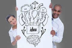 Portrait of man and woman holding billboard with various icons and text while standing against gray royalty free illustration