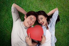 Portrait of man and woman holding red heart Stock Image