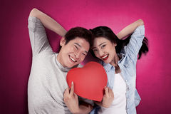Portrait of man and woman holding red heart Stock Images