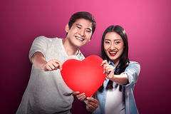 Portrait of man and woman holding red heart Royalty Free Stock Images