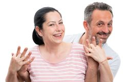Portrait of man and woman hugging and holding hands. Portrait of happy man and woman couple hugging and holding hands isolated on white studio background stock photography