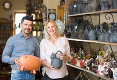 Portrait of man and woman shopping ceramic utensil in boutique Stock Photography