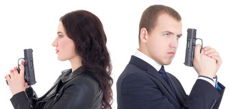 Portrait of man and woman special agents with guns isolated on w Royalty Free Stock Photo