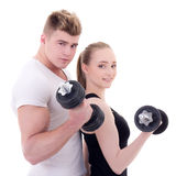 Portrait of man and woman in sportswear doing exercises with dum Royalty Free Stock Photos