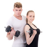 Portrait of man and woman in sportswear with dumbbells isolated Stock Photos