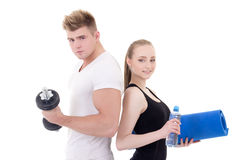 Portrait of man and woman in sportswear with dumbbells and yoga Royalty Free Stock Photos