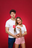 Portrait of a Man and Woman in the style of pin-up with candy in Stock Photography