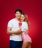 Portrait of a Man and Woman in the style of pin-up with candy in Royalty Free Stock Photos