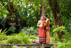 Portrait of man and woman in  traditional clothes. Royalty Free Stock Photography