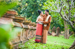 Portrait of man and woman in  traditional clothes. Royalty Free Stock Photos