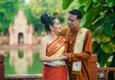 Portrait of man and woman in  traditional clothes. Stock Photo