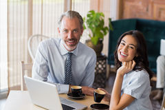 Portrait of man and woman using a laptop during meeting Royalty Free Stock Images