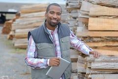 Portrait man in woodyard Royalty Free Stock Image