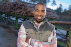 Portrait man in woodyard Stock Photo