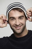 Portrait of man in woolly hat Royalty Free Stock Image